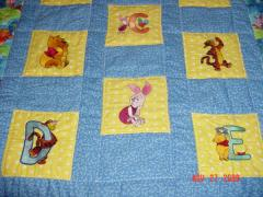 Winnie Pooh quilt with machine embroidery designs