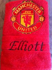 Embroidered towel with Manchester United logo