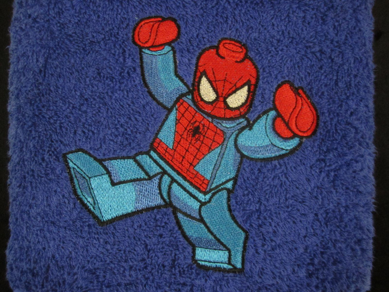 Towel with embroidered Lego Spiderman design