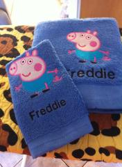 Embroidered Peppa Pig design at towel