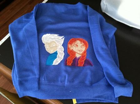 Embroidered longsleeve with Elsa and Anna applique designs