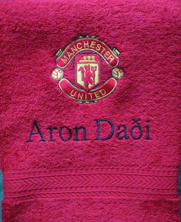 Embroidered towel with Manchester logo design