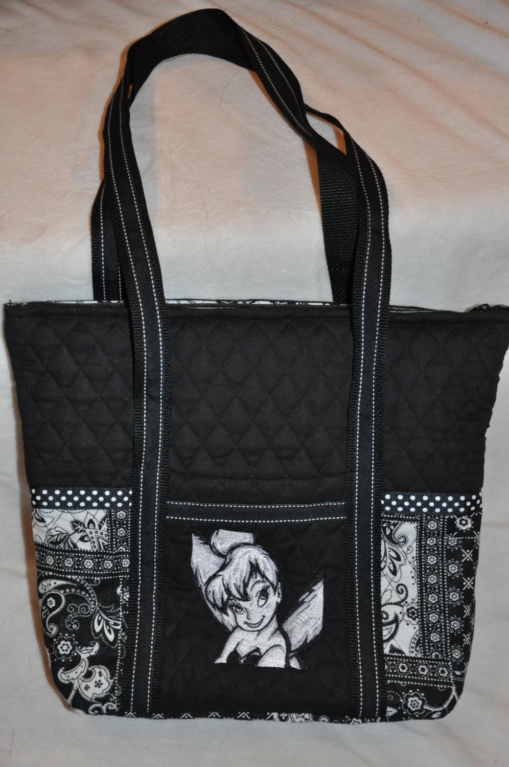 A bag with Tinker Bell head embroidered on it
