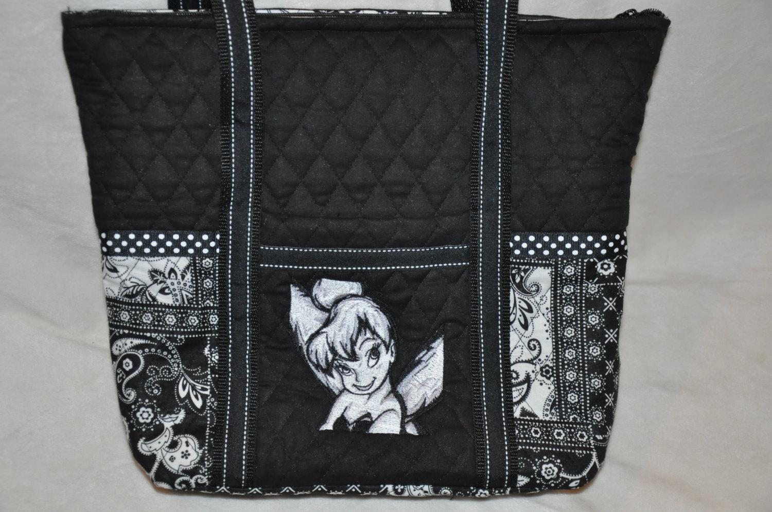 A bag with a head of Tinker Bell aka Tink embroidery design