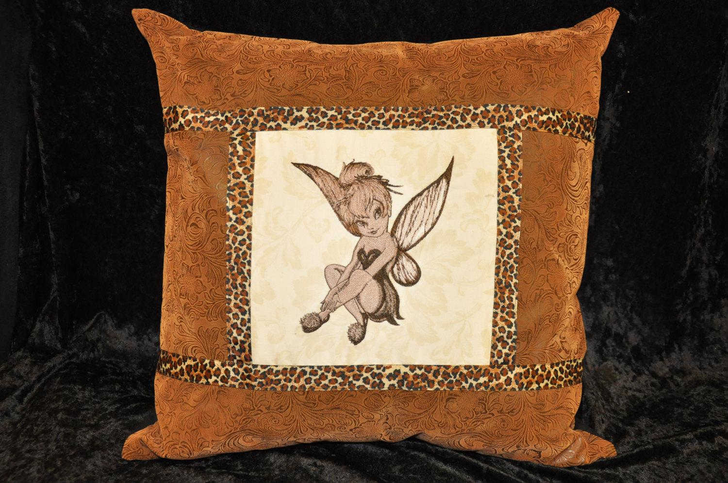 A pillow with Tinker Bell sitting embroidery design