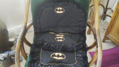 A set of pillows decorated with Batman logo