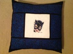 A pillow with a Catwoman embroidery design from Batman movies