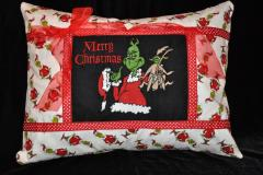 A pillow with Christmas Grinch embroidery design