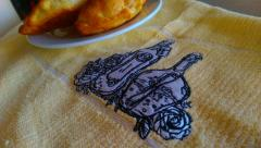 Embroidered napkin with Bottles design