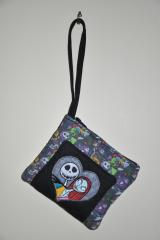 A purse with Jack Skellington and Sally embroidery design