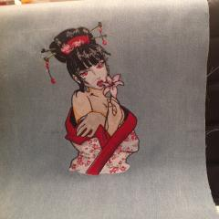 A Geisha with a flower embroidered design