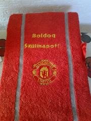A bath towel with a Manchester United fc logo embroidery design
