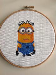 In round frame minion embroidery design