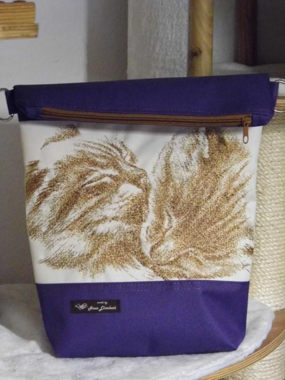 Embroidered bag with two cats