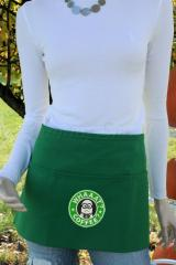 A green apron with a Starbucks minion embroidery design