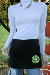 A black apron with a Starbucks minion embroidery design