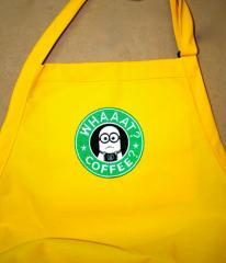 A yellow apron with a Starbucks minion embroidery design