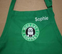 A green apron with a Starbucks minion and an inscription embroidery design