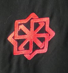 Embroidered oriental symbol in satin stitches