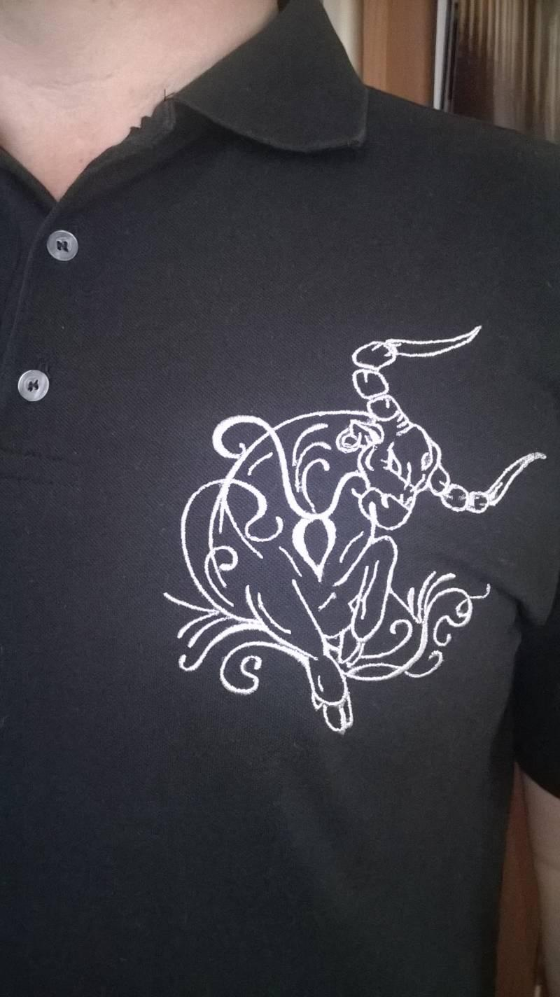 Tribal bull free embroidery design at T-shirt