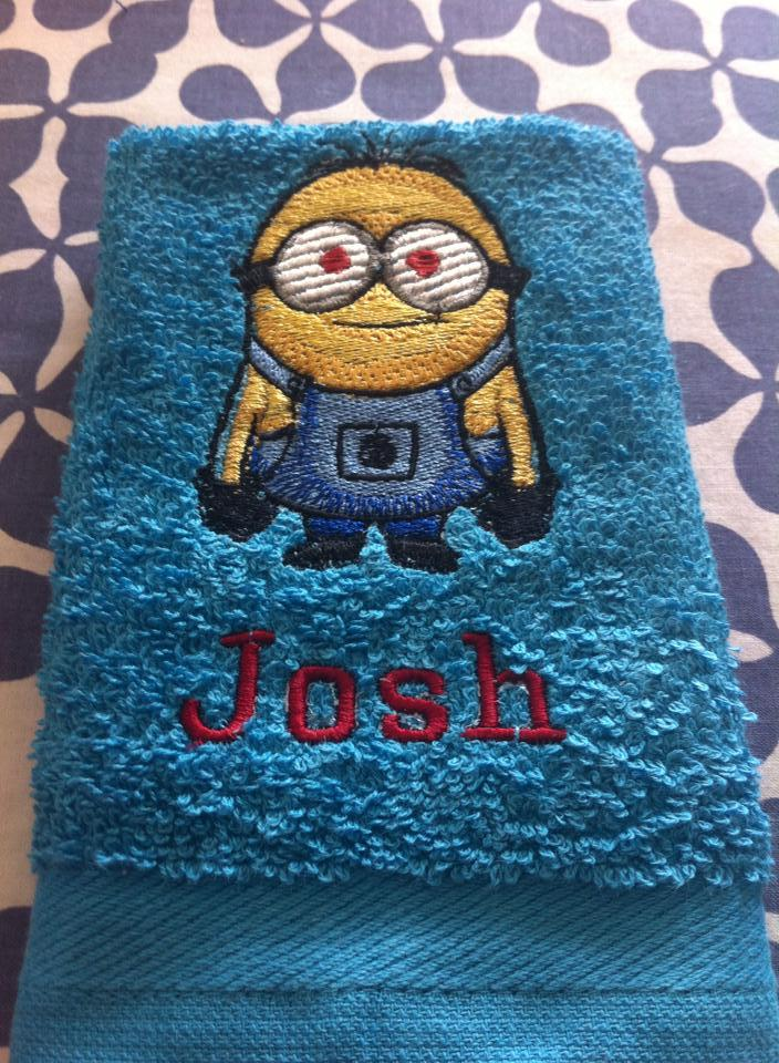 Blue towel with Minion embroidery design