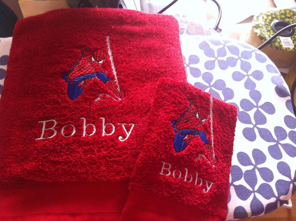 Two red bath towels with Spiderman embroidery design