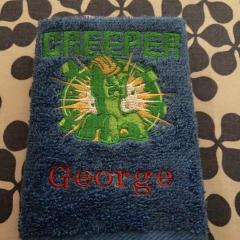 Towel with Minecraft Creeper embrodiery design