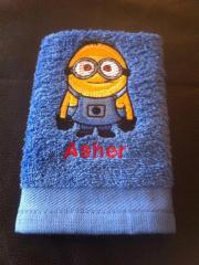 Bath towel with Minion embroidery design
