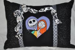 Jack and Sally embroidered pillow with a bow