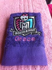 Bath towel with Monster High logo embroidery design