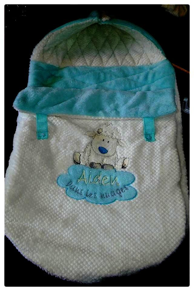 Angel's Nest: embroidered baby envelope with sheep design