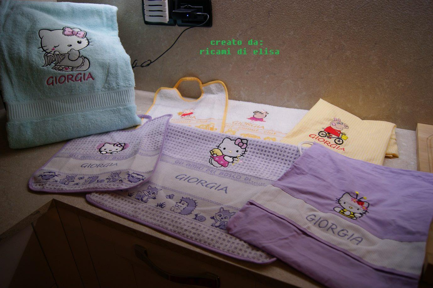 Baby set with Hello Kitty and Peppa pig embroidery designs