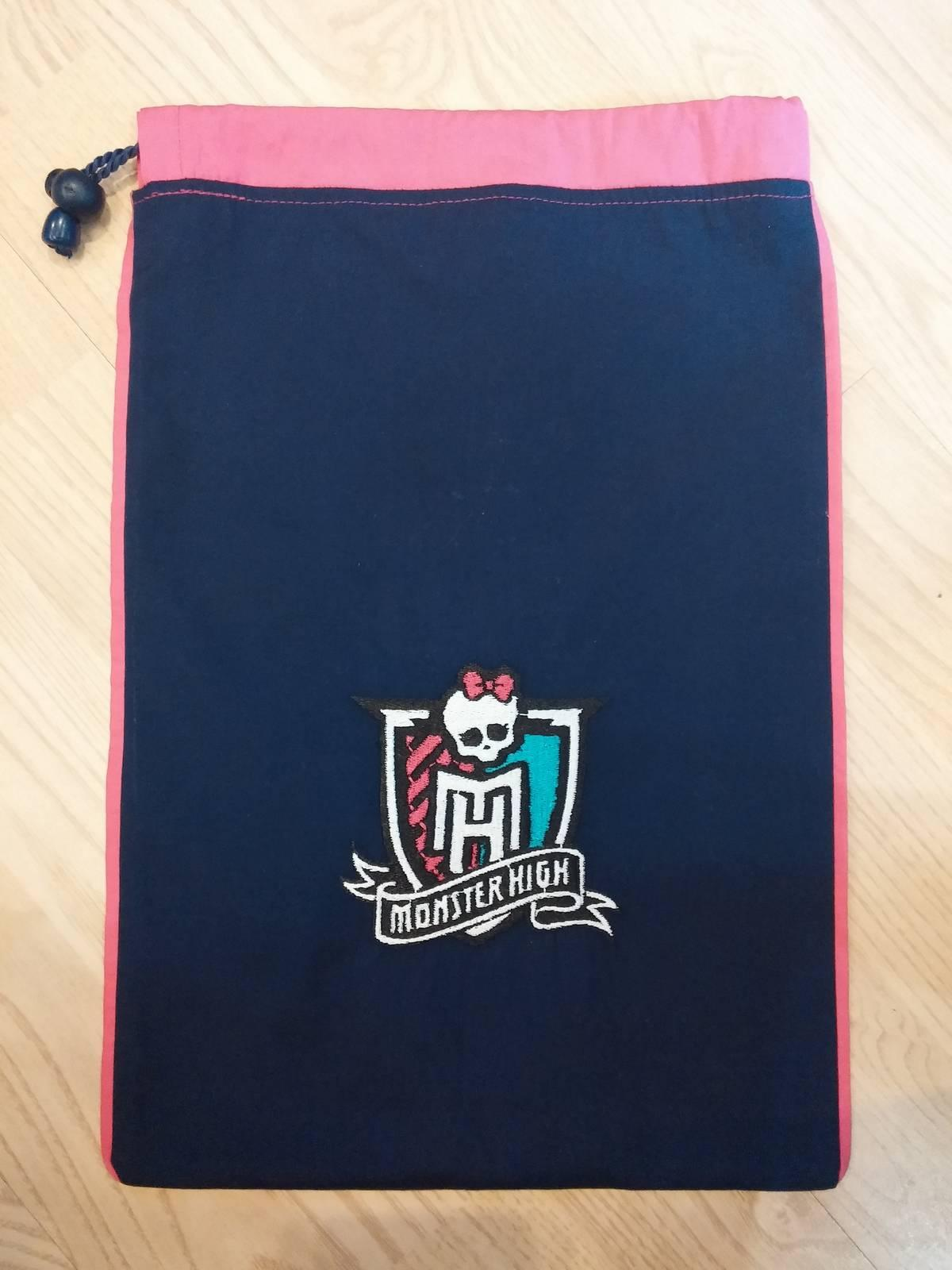 Embroidered school bag with Monster High logo design