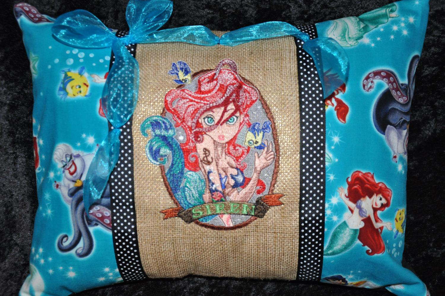Cushion with Siren embroidery design