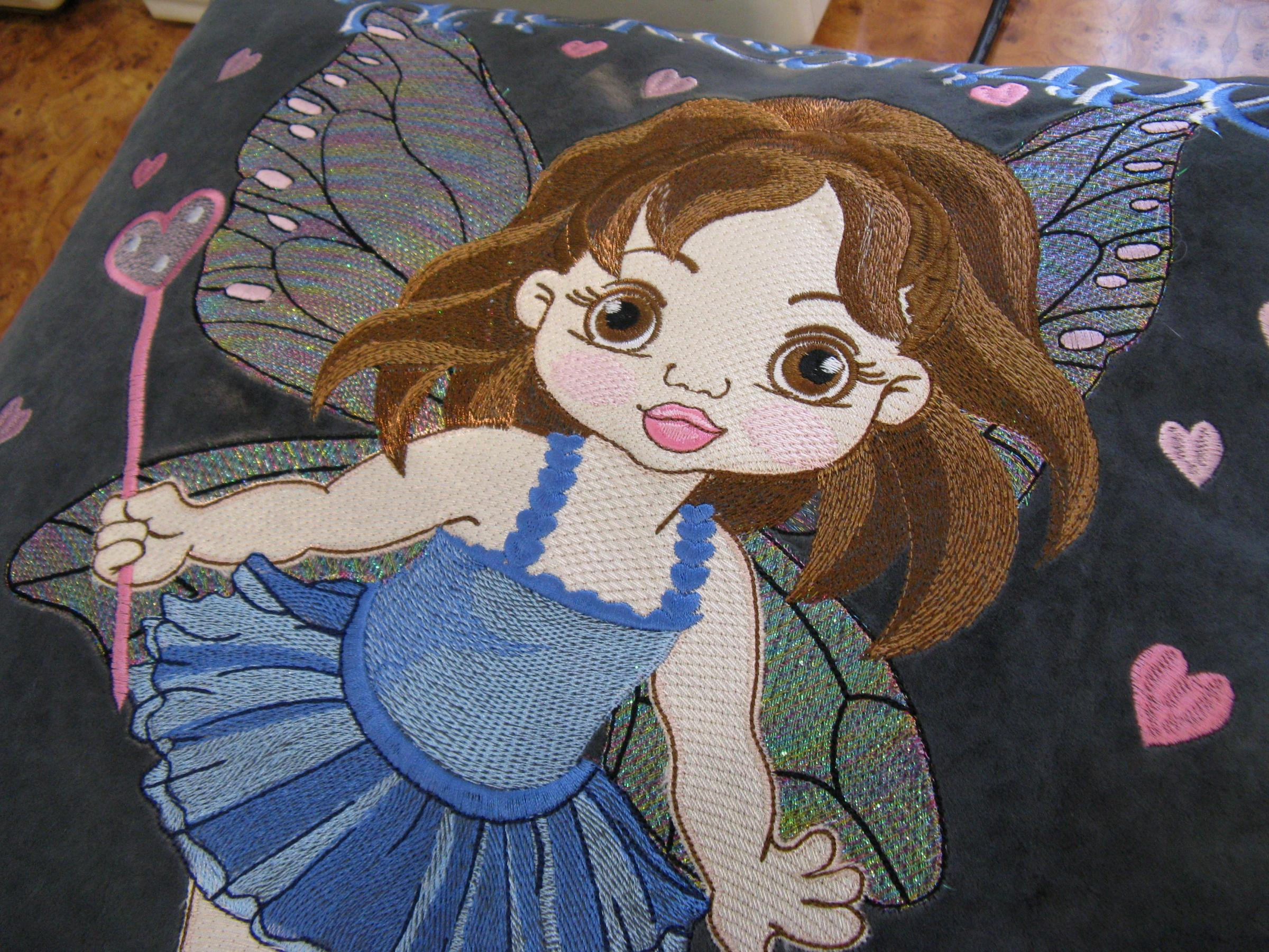 Sofa cushion with Baby love fairy embroidery design