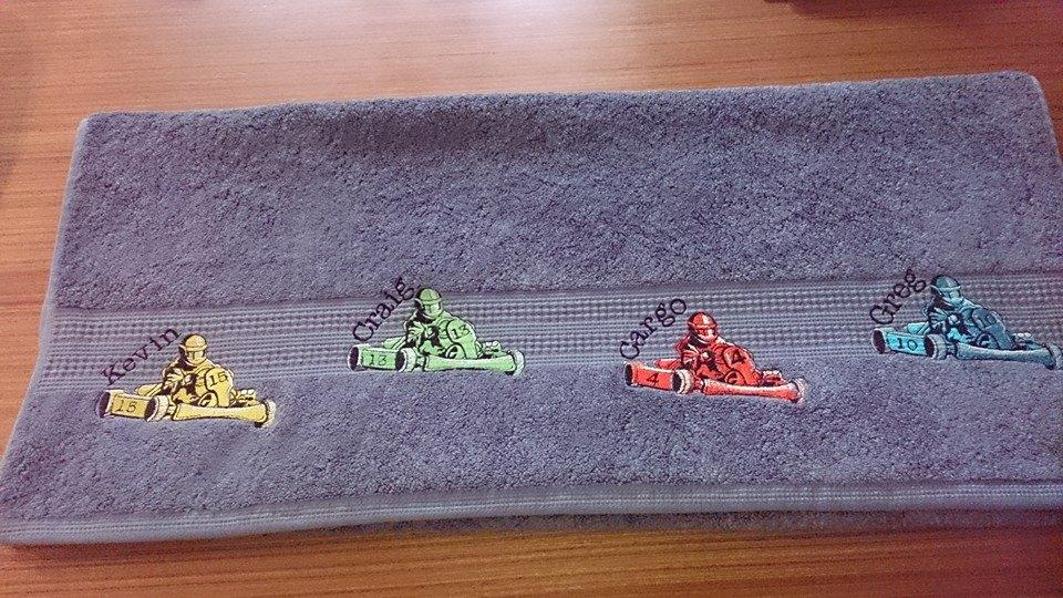 Bath towel with Karting embroidery design