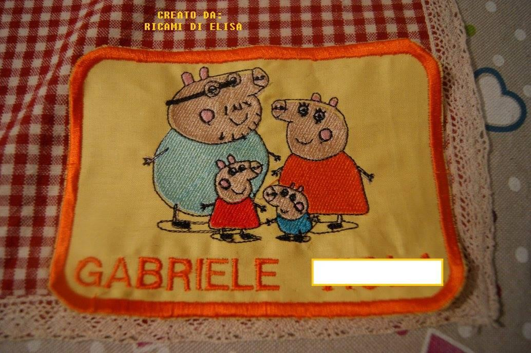 Baby bib with Peppa Pig world embroidery design