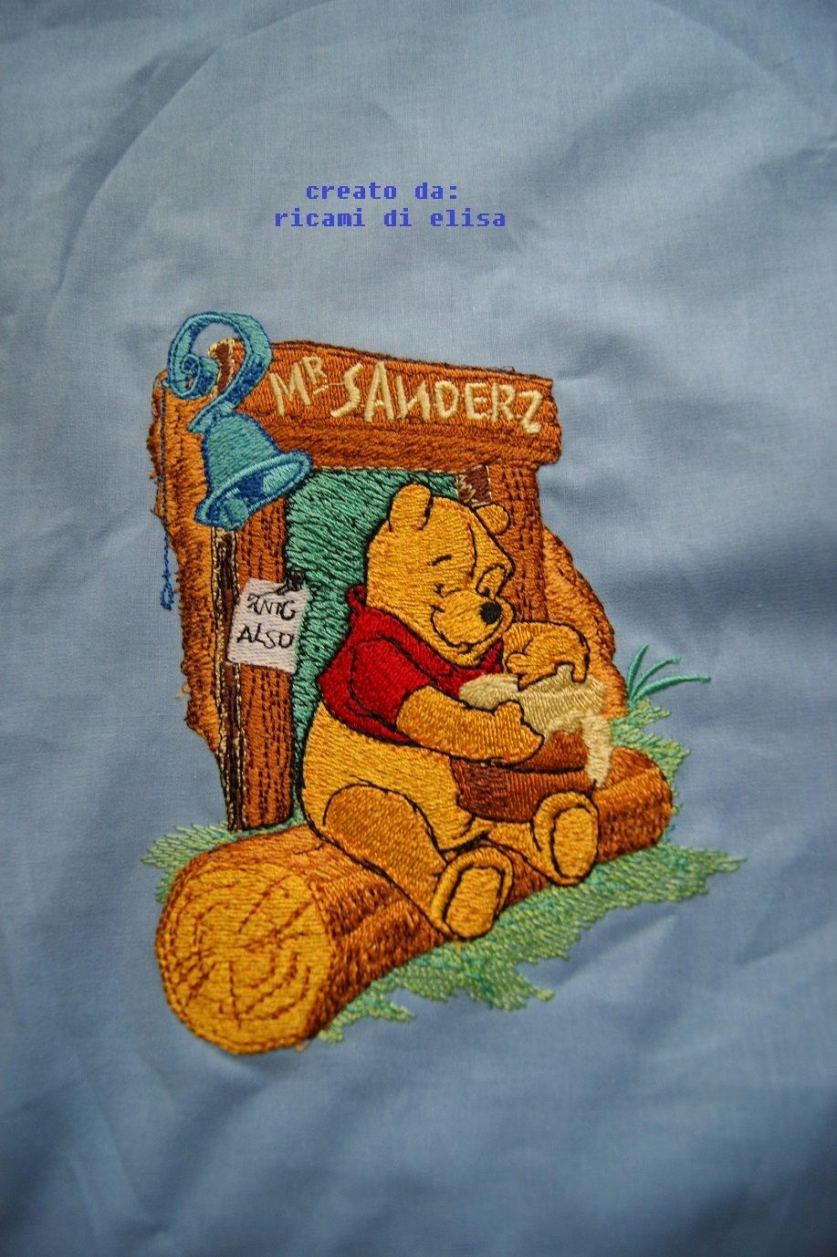 Winnie Pooh and honey embroidery design