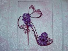 Shoes on a high heel decorated with orchid embroidery design