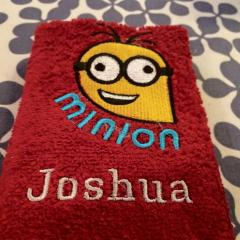 Bathroom towel with Crazy Minion embroidery design