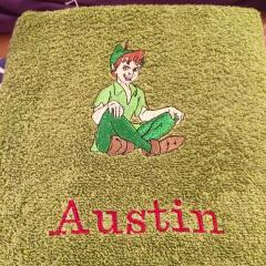 Towel with Peter Pan embroidery design
