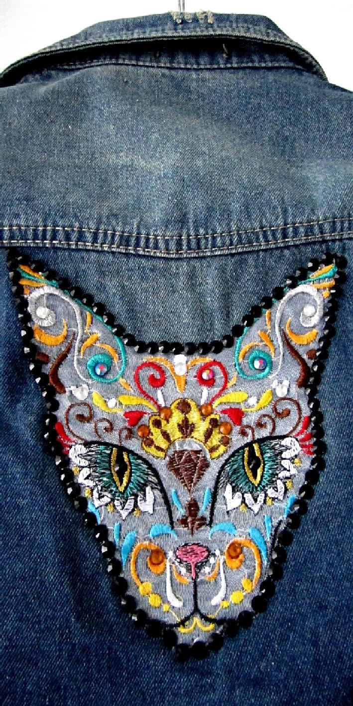 Denim jacket with Mexican cat embroidery design