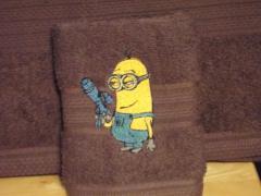 Minion with gun embroidery design