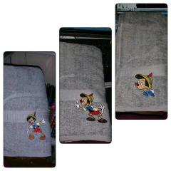 Towels with Pinocchio embroidery designs