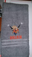 Towel with Yosemite Sam with guns embroidery design