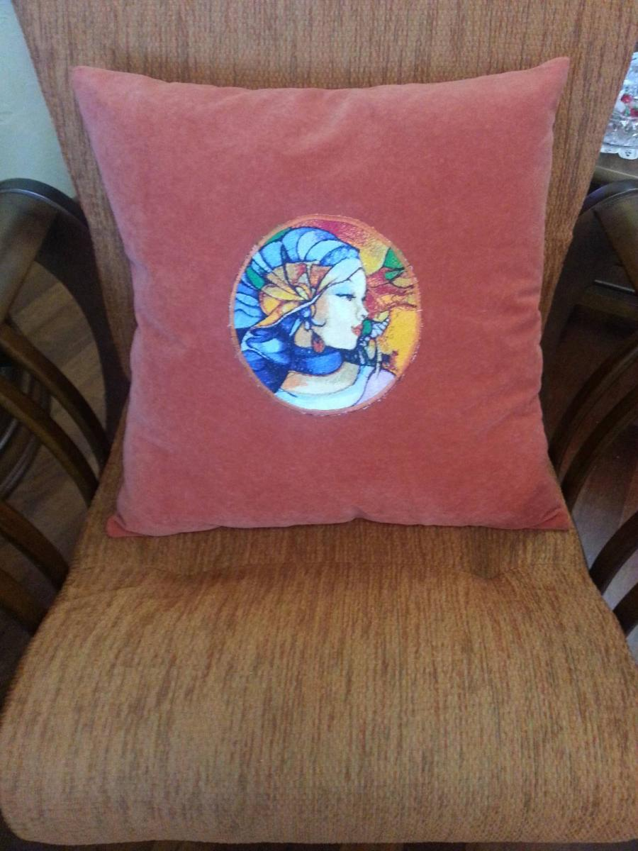 Pillow with magic woman stitch free embroidery design