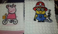 Towels with cartoon characters embroidery design
