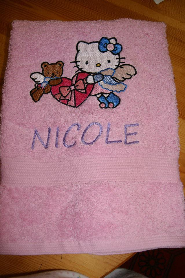 Towel with Hello Kitty snow angel embroidery design