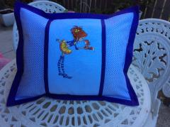 Garden cushion with Girl and squirrel embroidery design