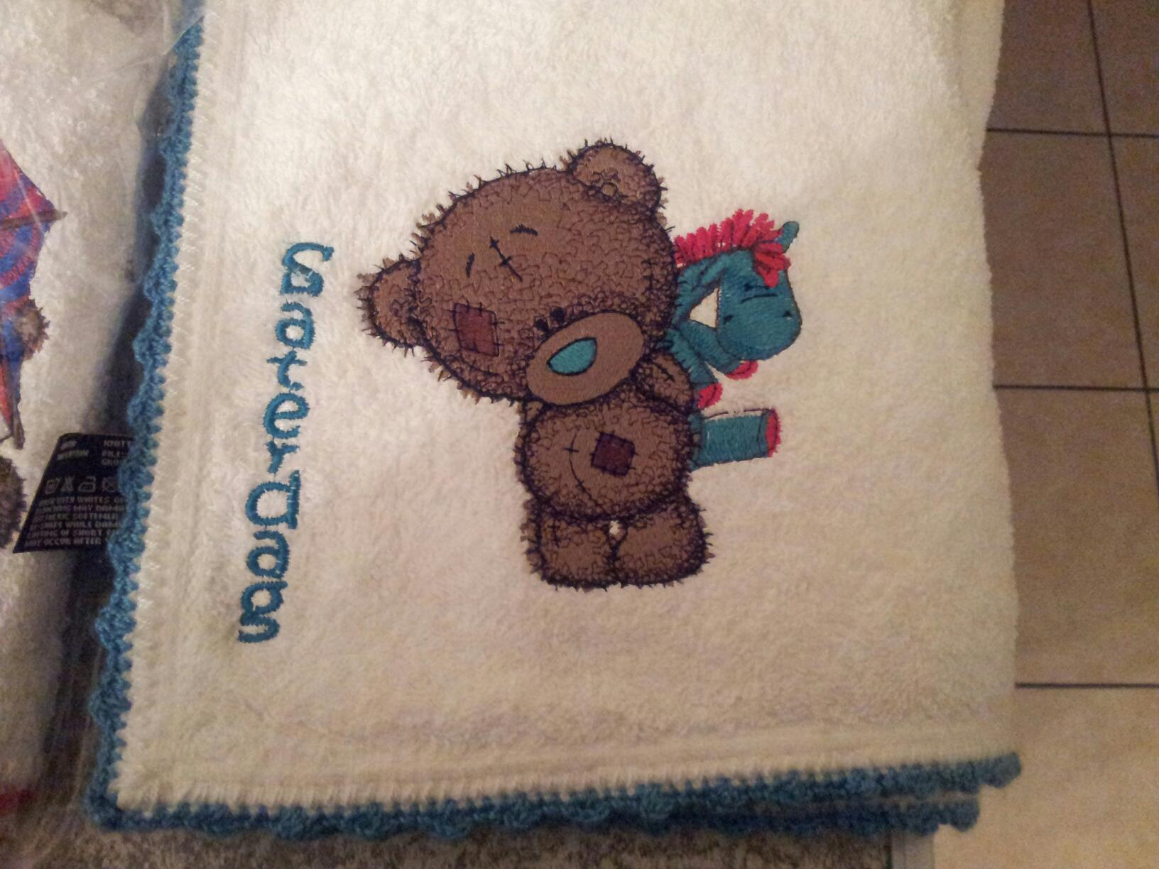 Quilt block with Teddy Baby with toy machine embroidery design
